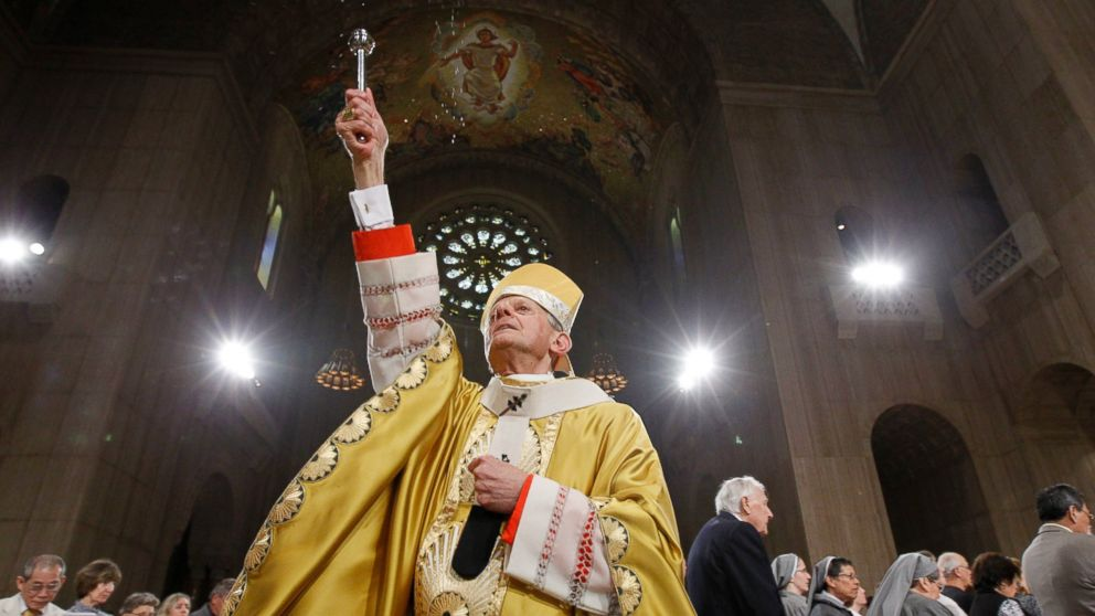 In this Sunday, April 24, 2011 file photo, Cardinal Donald Wuerl, Archbishop of Washington, sprinkles Holy Water during Easter Mass at the Basilica of the National Shrine of the Immaculate Conception Roman Catholic Church in Washington.