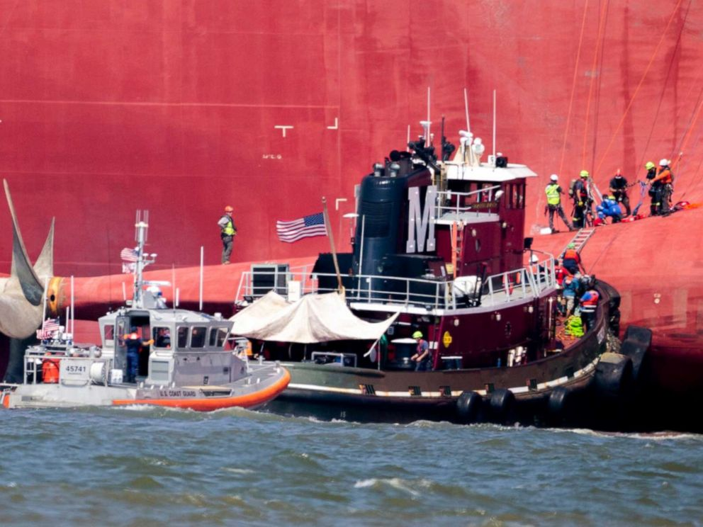 PHOTO: Rescuers work near the stern of the vessel Golden Ray as it lays on its side near the Moran tug boat Dorothy Moran, Monday, Sept. 9, 2019, in Jekyll Island, Ga.