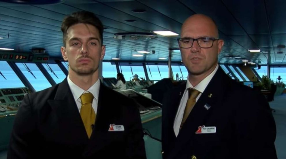 Carnival Glory Captain Pero Grubjesic and Safety Officer Cesare Mattera discuss the rescue of a crew member from a Norwegian cruise ship on Sunday, July 1, 2018.