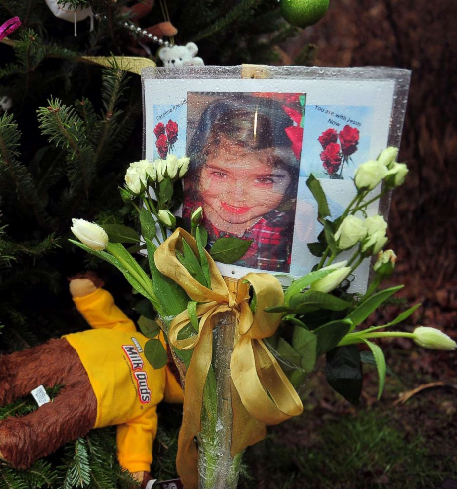 PHOTO: A photo of Caroline Previdi, one of the victims from the Sandy Hook elementary school shooting is set up at a makeshift shrine to the victims in Newtown, Conn., Dec. 17, 2012.