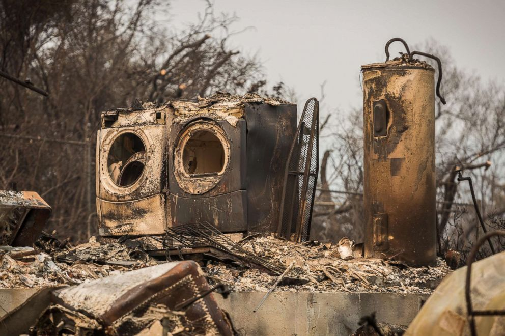 PHOTO: A washer, dryer and a hot water heater are the largest remains of a home that burned during the Carr Fire on Ridge Drive in Redding, Calif., Aug. 2, 2018.