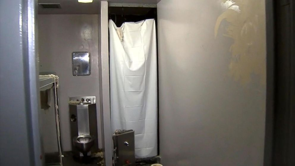 Inmate on the run after breaking through shower wall to