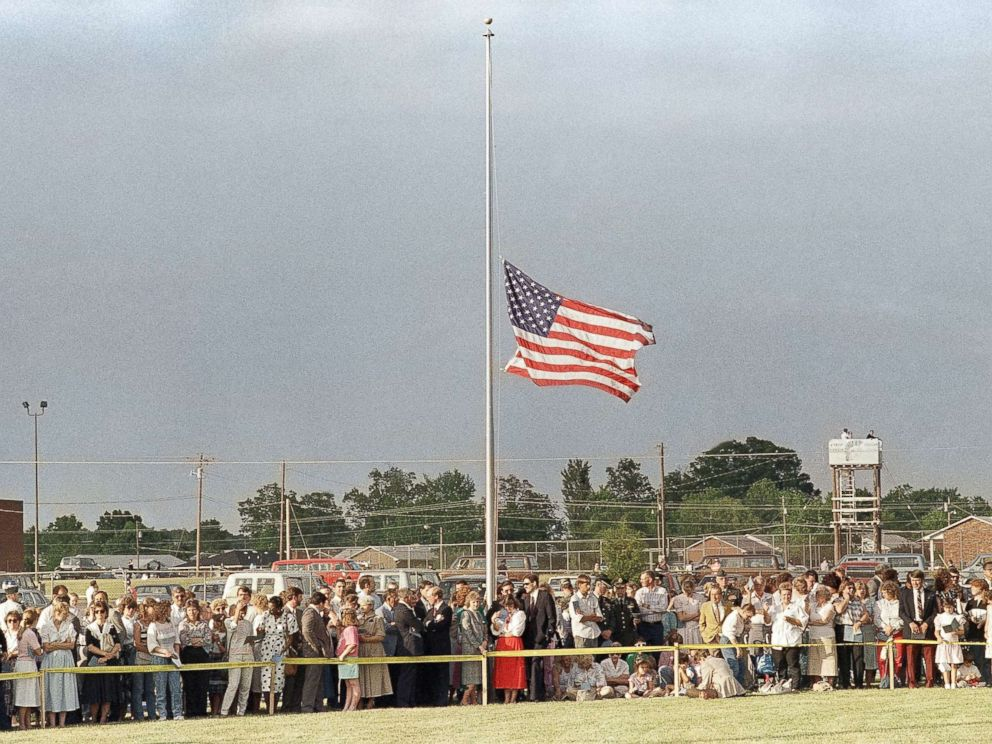 PHOTO: The American flag flies at half must during a memorial service attended by thousands at the North Hardin School football stadium in Radcliff, Ky. on May 19, 1988, in honor of the 27 people killed in a bus accident near Carrollton.