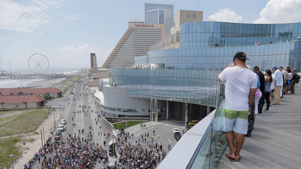 People gather on the boardwalk and the balconies to watch a ribbon cutting ceremony for the Ocean Resort Casino in Atlantic City, N.J., June 28, 2018.