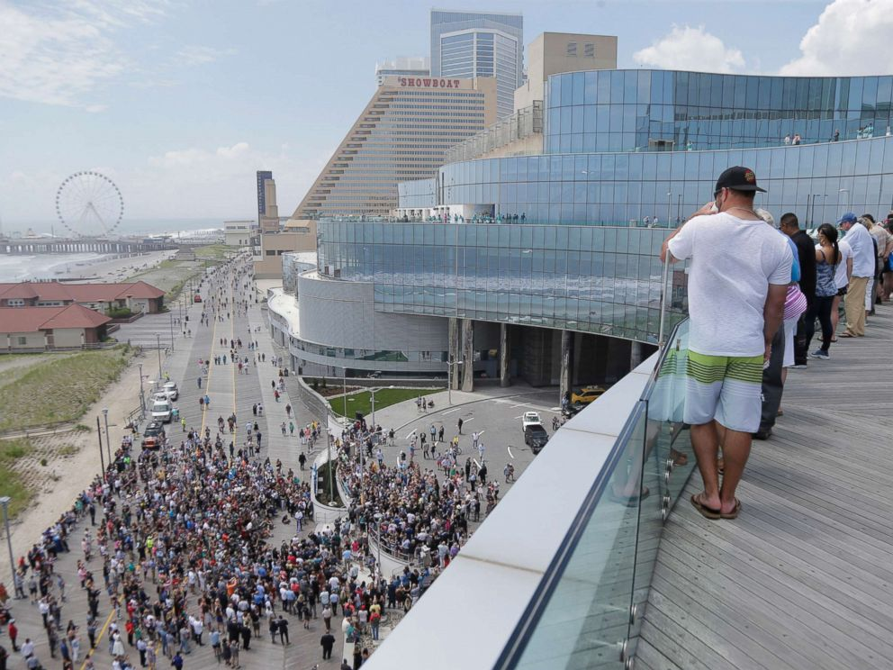 PHOTO: People gather on the boardwalk and the balconies to watch a ribbon cutting ceremony for the Ocean Resort Casino in Atlantic City, N.J., June 28, 2018.