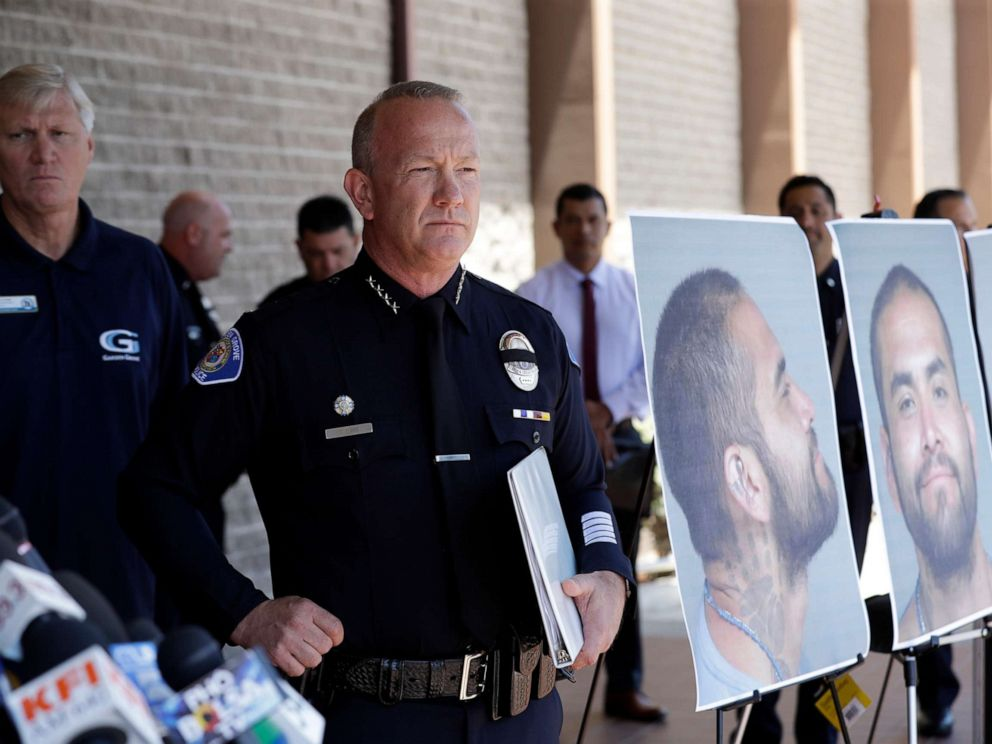 PHOTO: Garden Grove Police Chief Tom DaRe prepares to address the media next to a booking mug shot of Zachary Castaneda posted outside of the Garden Grove Police Department headquarters in Garden Grove, Calif., Aug. 8, 2019.