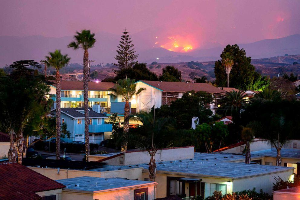 PHOTO: The Cave fire burns a hillside above houses in Santa Barbara, Calif., Nov. 26, 2019.