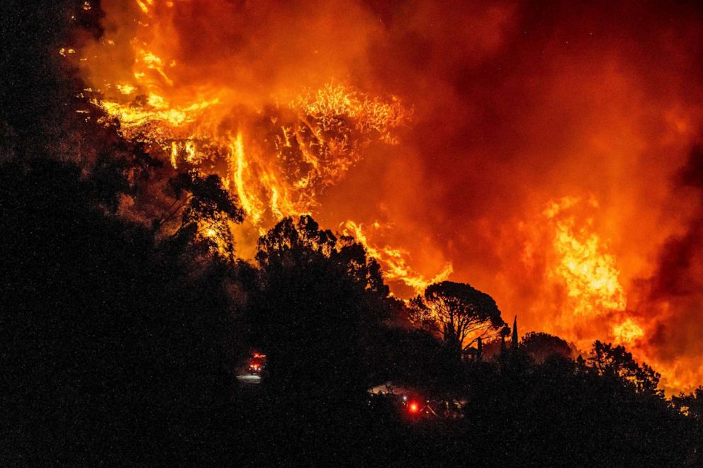 PHOTO: The Cave Fire burns a hillside near homes in Santa Barbara, Calif., November 26, 2019.
