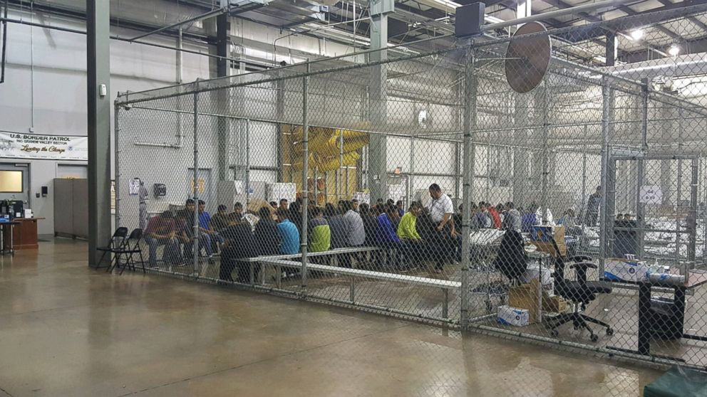 People sit in a cell at the U.S. Customs and Border Protection agency's Rio Grande Valley Centralized Processing Center in McAllen, Texas, June 17, 2018.