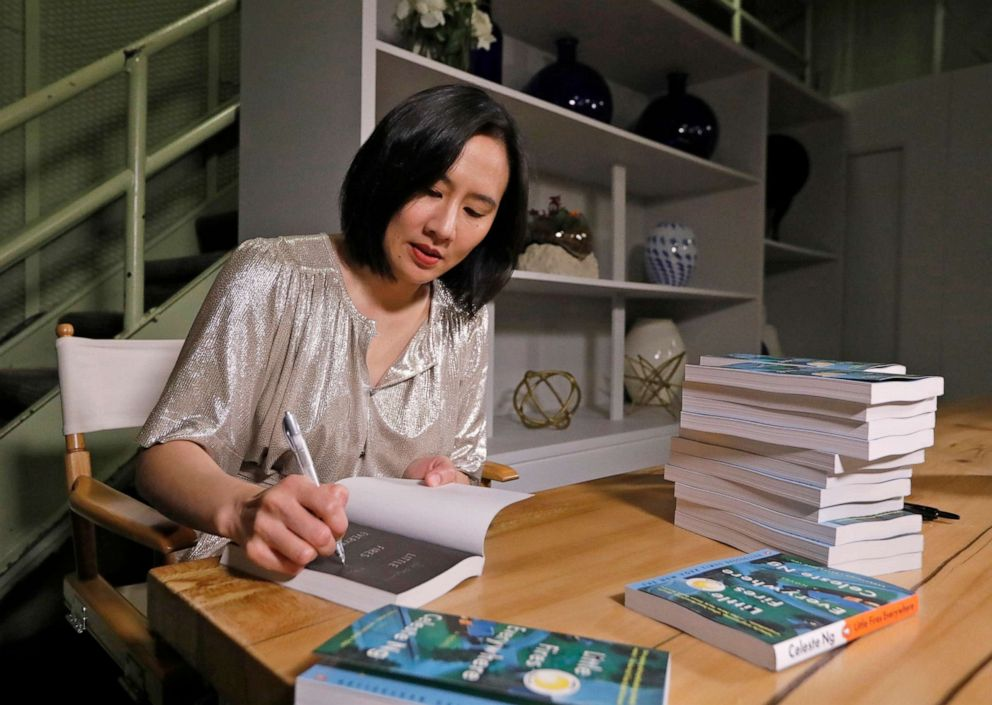 PHOTO: Author Celeste Ng signs copies of her bestselling book, Little Fires Everywhere.