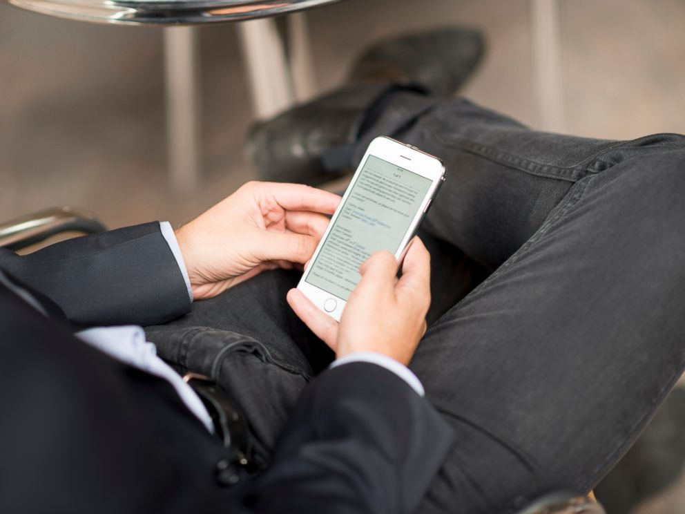 PHOTO: A businessman is seen checking his email and texting on his cell phone in this undated stock image.