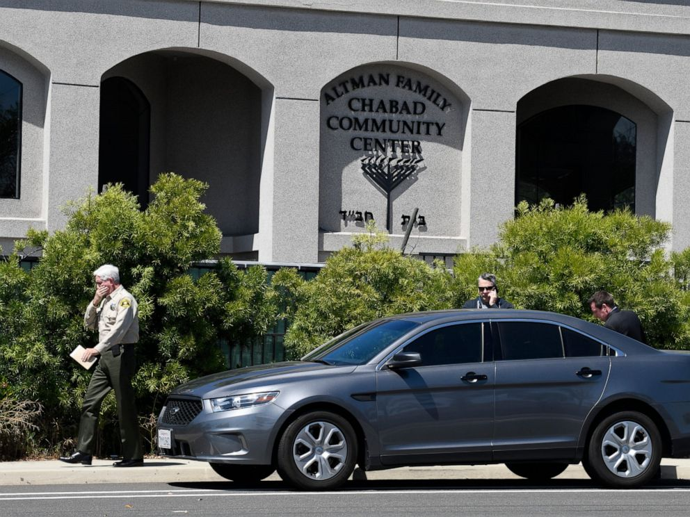 PHOTO: San Diego County Sheriff Bill Gore, left, walks past the Chabad of Poway Synagogue Saturday, April 27, 2019, in Poway, Calif. Several people were injured in a shooting at the synagogue.