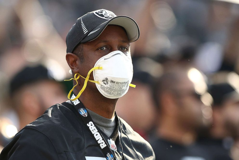 PHOTO: A fan wears a face mask in the stands during the NFL game between the Oakland Raiders and the Los Angeles Chargers at Oakland-Alameda County Coliseum, Nov. 11, 2018 in Oakland, Calif.