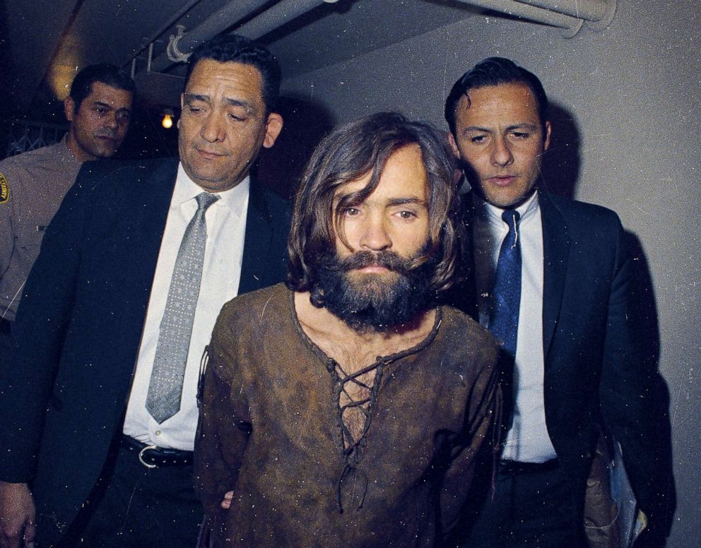 PHOTO: Charles Manson is escorted to his arraignment on conspiracy-murder charges in conneciton with the Sharon Tate murder case, 1969, in Los Angeles.
