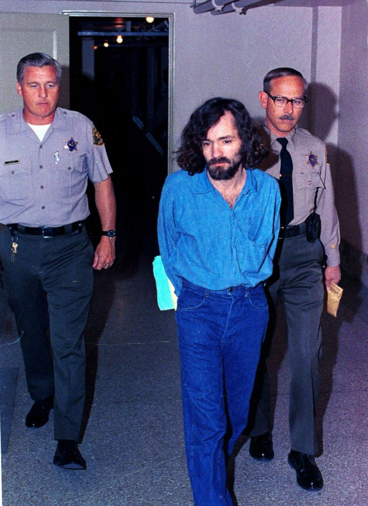 PHOTO: This Aug. 20, 1970, file photo shows Charles Manson, head of the cult the Manson Family being escorted by deputy sheriffs on his way to court, in Los Angeles, after being charged with murder-conspiracy in the Tate-LaBianca slayings.