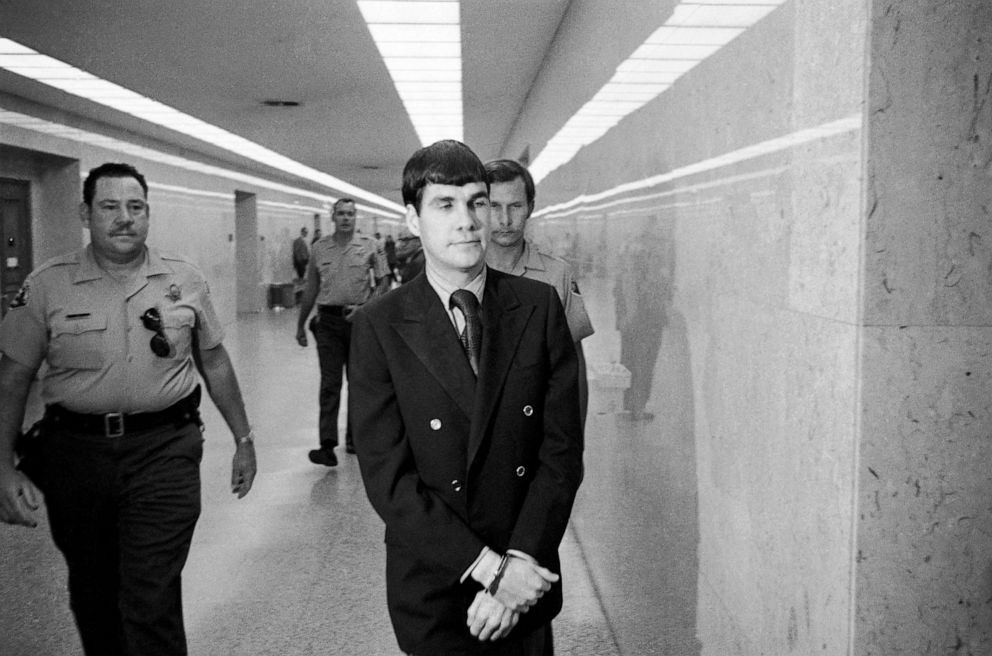 PHOTO: Charles Tex Watson, center, is led back to jail from a courtroom after he was convicted of seven counts of first degree murder and one of conspiracy to commit murder in the Tate-LaBianca slayings, Oct. 12, 1971, Los Angeles.