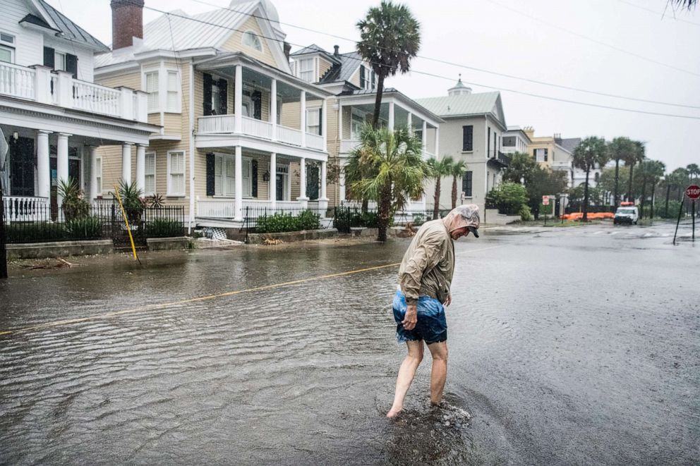 PHOTO: Bill Olesner walks down South Battery Street while cleaning debris from storm drains on Sept. 5, 2019 in Charleston, S.C. as Hurricane Dorian brings wind and rain to the area.