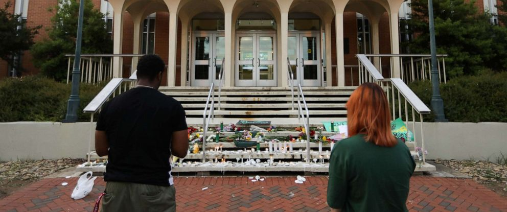 PHOTO: Students lay candles and flowers at the steps of Kennedy Hall to honor the victims of a shooting the day earlier at the University of North Carolina Charlotte, in Charlotte, N.C. on May 1, 2019.