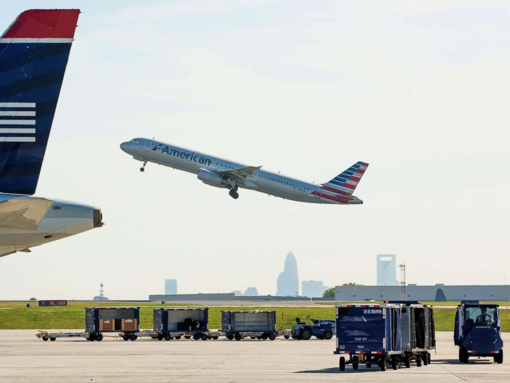 PHOTO: An American Airlines planes takes off as staff and employees at Charlotte Douglas International Airport in Charlotte, N.C. on Sept. 17, 2015.