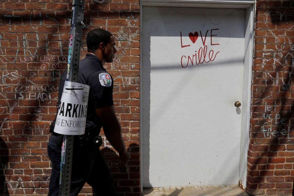 "A police officer walks past the site where Heather Heyer was killed during the 2017 Charlottesville ""Unite the Right"" protests in Charlottesville, Va., Aug. 10, 2018."