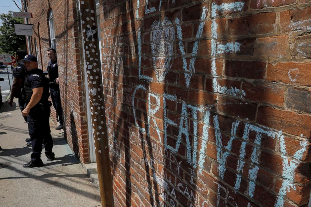 "A police officer patrols at the site where Heather Heyer was killed during the 2017 Charlottesville ""Unite the Right"" protests in Charlottesville, Va.,  Aug. 10, 2018."