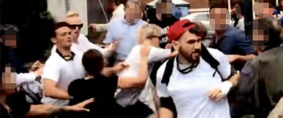 """PHOTO: Federal investigators state in charging documents that this video grab shows Thomas Gillen, Benjamin Daley, Cole White and Michael Miselis committing violent acts at the """"Unite the Right"""" rally in Charlottesville, Va., in 2017."""