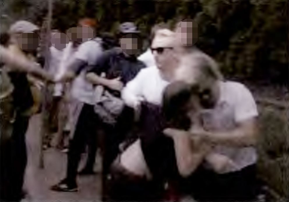 PHOTO: A video grab included in the charging documents allegedly shows Cole White headbutting a female counter protester with the assistance of Benjamin Daley at the Unite the Right rally in Charlottesville, Va., in 2017.