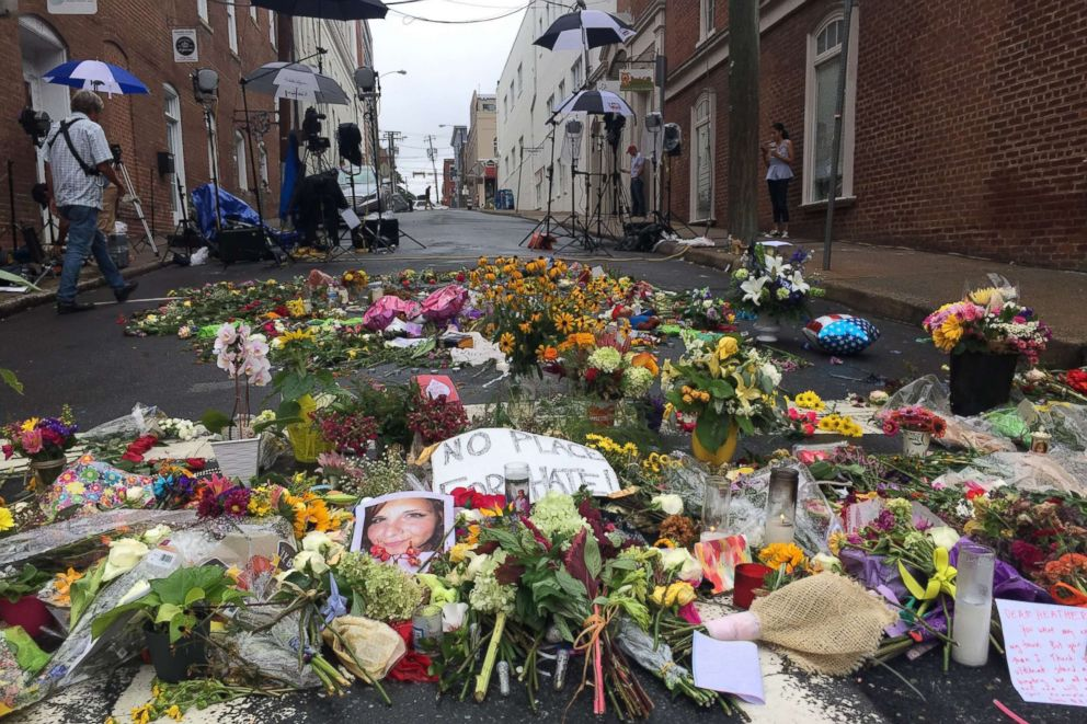 PHOTO: lowers are left in the street creating a make-shift memorial for Heather Heyer, who was killed during the 2017 protests in Charlottesville, Va.