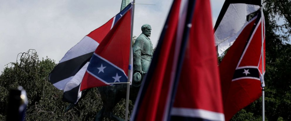 PHOTO: Members of white nationalists rally around a statue of Robert E. Lee in Charlottesville, Virginia, August 12, 2017.