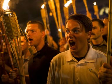 PHOTO: A group primarily composed of self-identified Neo Nazis, Alt-Right and White Supremacists chants at counter-protesters after marching through the UVA campus with torches in Charlottesville, Va., Aug. 11, 2017.
