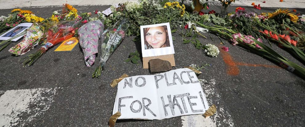 PHOTO: Flowers surround a photo of 32-year-old Heather Heyer, who was killed when a car plowed into a crowd of people protesting against the white supremacist Unite the Right rally, Aug. 13, 2017 in Charlottesville, Va.