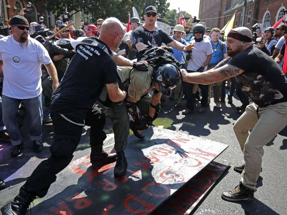 PHOTO: White nationalists, neo-Nazis, the KKK and members of the alt-right clash with counter-protesters outside Emancipation Park during the Unite the Right rally Aug. 12, 2017 in Charlottesville, Va.