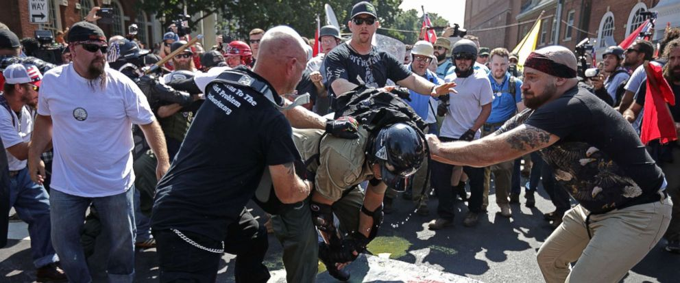 "PHOTO: White nationalists, neo-Nazis, the KKK and members of the ""alt-right"" clash with counter-protesters outside Emancipation Park during the Unite the Right rally on Aug. 12, 2017 in Charlottesville, Va."
