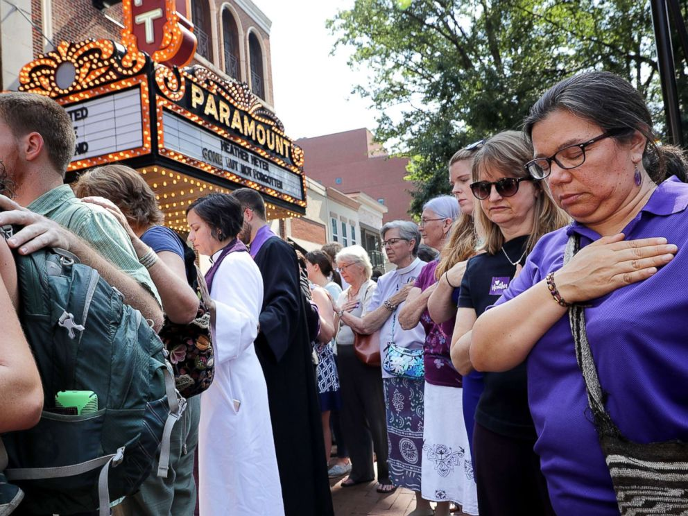 PHOTO: People observe a moment of silence during the memorial service for Heather Heyer outside the Paramount Theater, Aug. 16, 2017, in Charlottesville, Va.