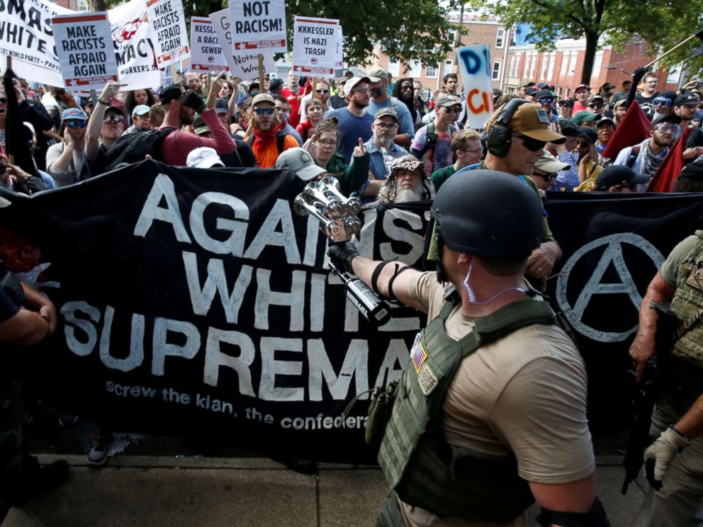 PHOTO: Members of white nationalists are met by a group of counter-protesters in Charlottesville, Va., Aug. 12, 2017.