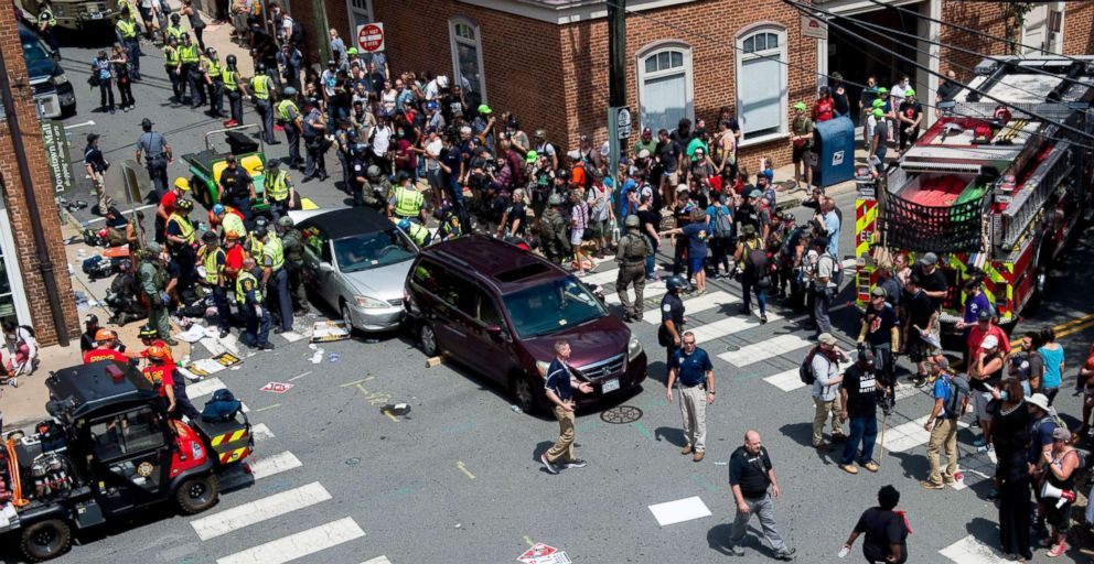 People receive first-aid after a car ran into a crowd of protesters in Charlottesville, Va., Aug. 12, 2017.