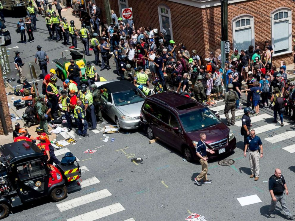 PHOTO: People receive first-aid after a car ran into a crowd of protesters in Charlottesville, Va., Aug. 12, 2017.