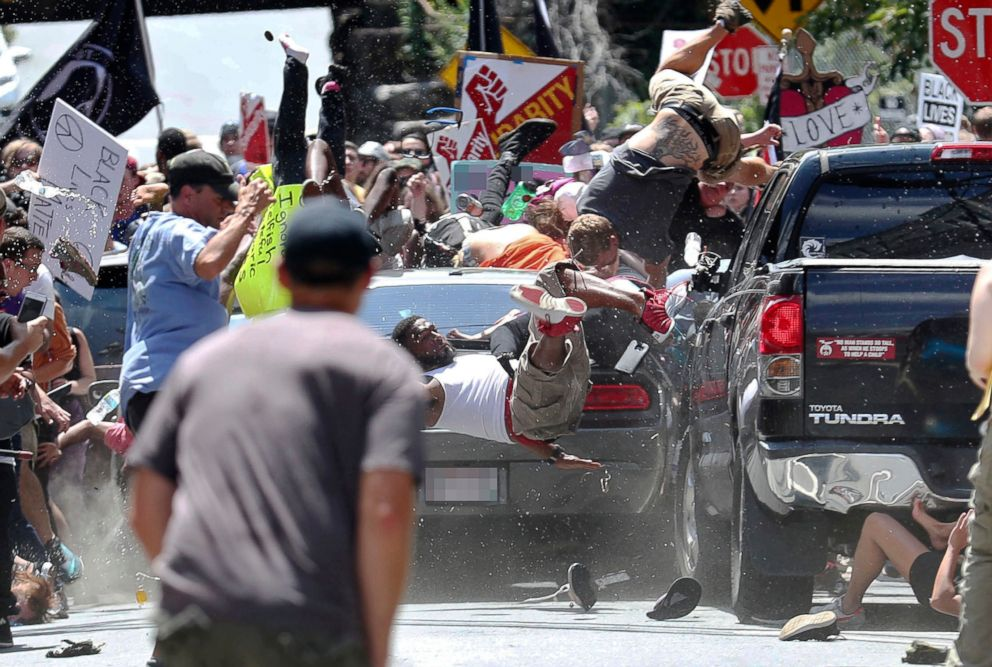 People fly into the air as a vehicle drives into a group of protesters demonstrating against a white nationalist rally in Charlottesville, Va., Aug. 12, 2017.
