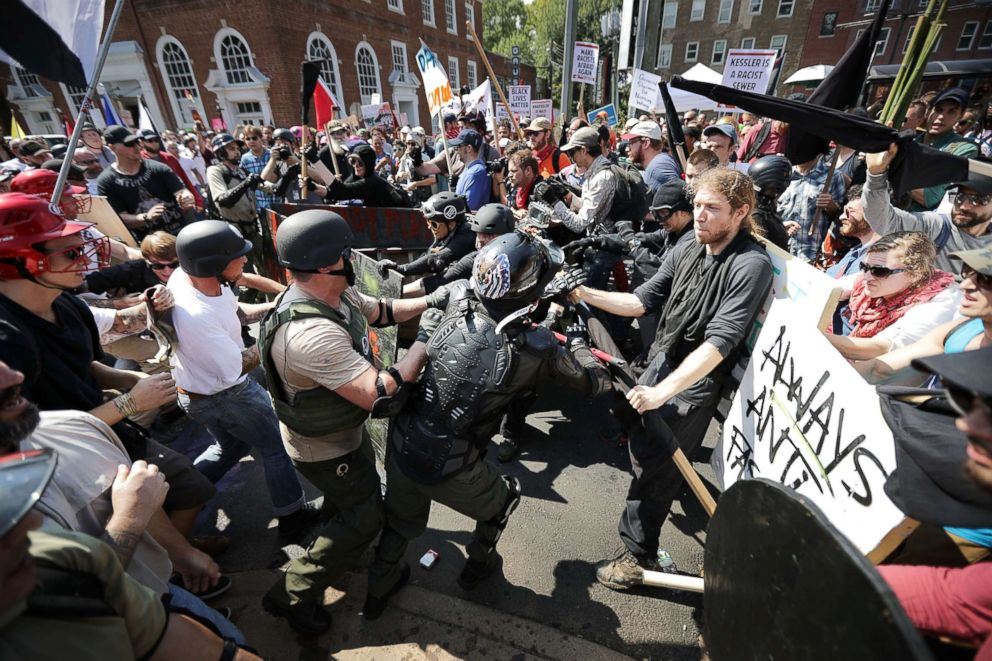 White nationalists, neo-Nazis and members of the extreme right clash with counter-protesters as they enter Lee Park during a rally on Aug. 12, 2017 in Charlottesville, Va.