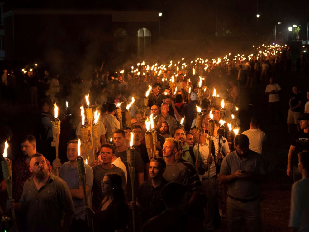 PHOTO: White nationalists carry torches on the grounds of the University of Virginia, on the eve of a planned Unite The Right rally in Charlottesville, Va., Aug. 11, 2017.
