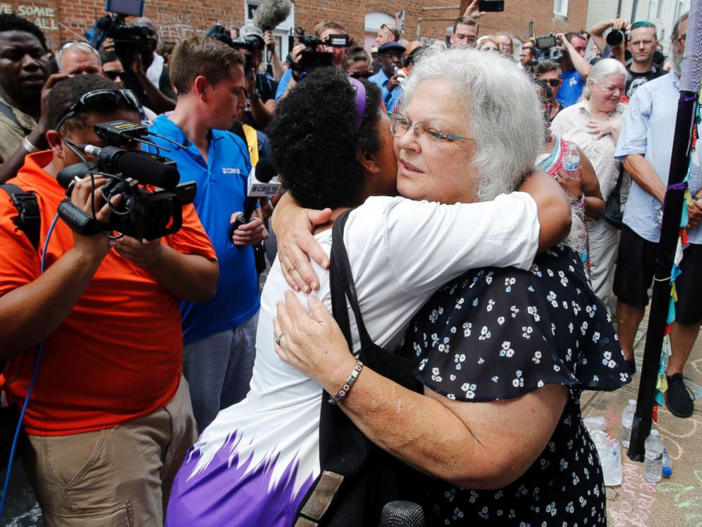 PHOTO: Susan Bro, the mother of Heather Heyer who was killed during last years Unite the Right rally, embraces supporters after laying flowers at the spot her daughter was killed in Charlottesville, Va., Aug. 12, 2018.