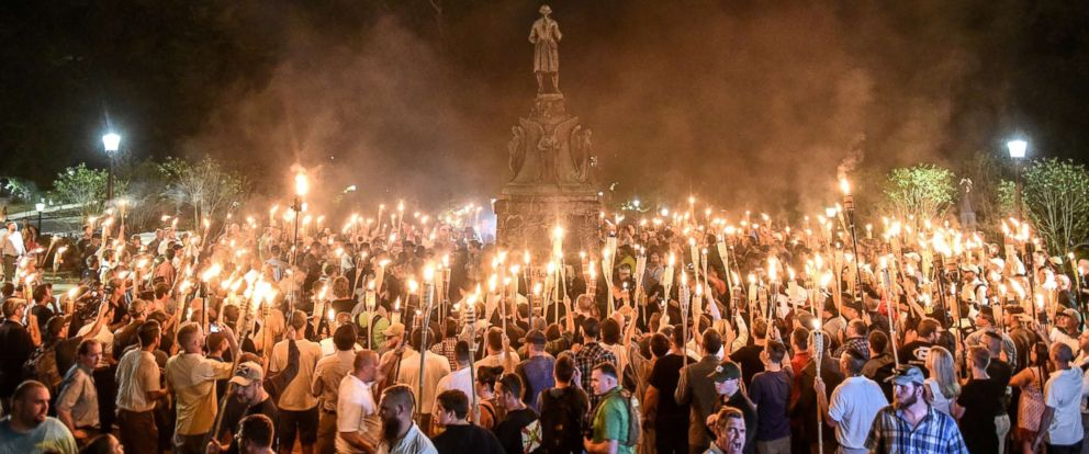PHOTO: White nationalists participate in a torch-lit march on the grounds of the University of Virginia ahead of the Unite the Right Rally in Charlottesville, Va. on Aug. 11, 2017.