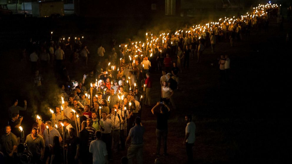 White nationalists and far right extremists march through the University of Virginia Campus with torches in Charlottesville, Va., Aug. 11, 2017.
