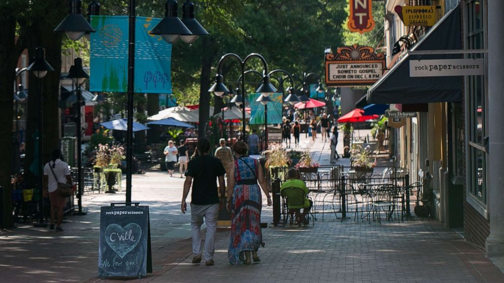 People walk down the open air mall in downtown Charlottesville, Va., Aug. 10, 2018.