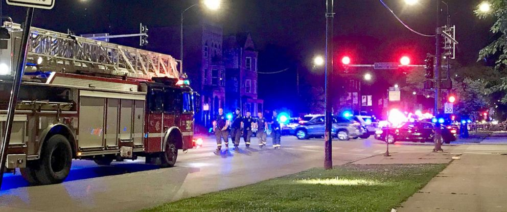PHOTO: Chicago Fire Department paramedics respond to a shooting in the 2900 block of West Roosevelt Road, when seven people were wounded by gunfire around 1:20 a.m. in Douglas Park in Chicago, Ill., Aug. 4, 2019.
