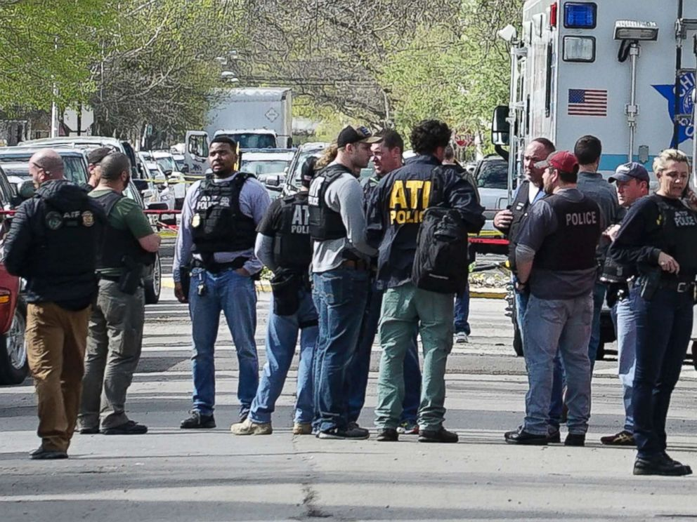 PHOTO: Police from various agencies investigate the scene where a Bureau of Alcohol, Tobacco, Firearms and Explosives agent was shot, Friday, May 4, 2018, in Chicago.