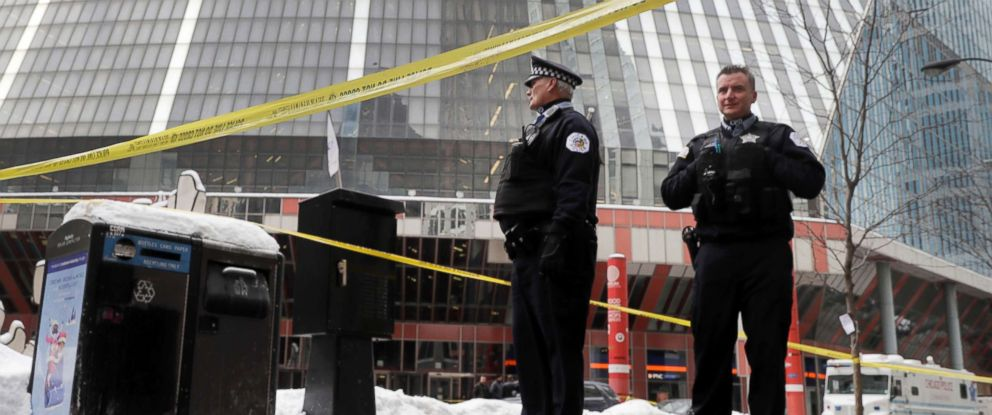 PHOTO: Chicago police officers remain on the scene outside the James R. Thompson Center after on-duty Police Cmdr. Paul Bauer was shot several times, Feb. 13, 2018, in Chicago.