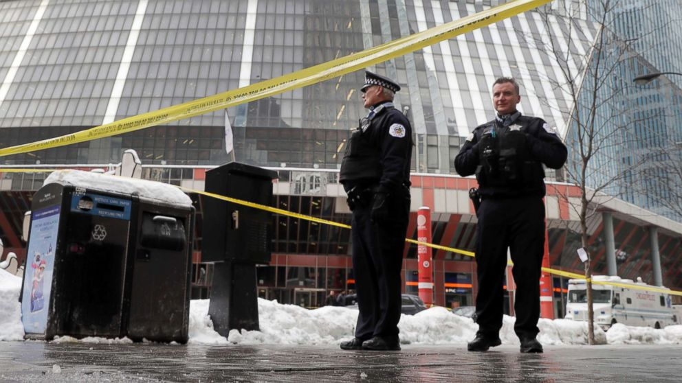Chicago police officers remain on the scene outside the James R. Thompson Center after on-duty Police Cmdr. Paul Bauer was shot several times, Feb. 13, 2018, in Chicago.
