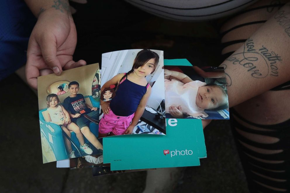 PHOTO: Amber Ayala looks through pictures of her brothers and sisters who were killed in an early-morning fire in the Little Village neighborhood, Aug. 26, 2018, in Chicago.