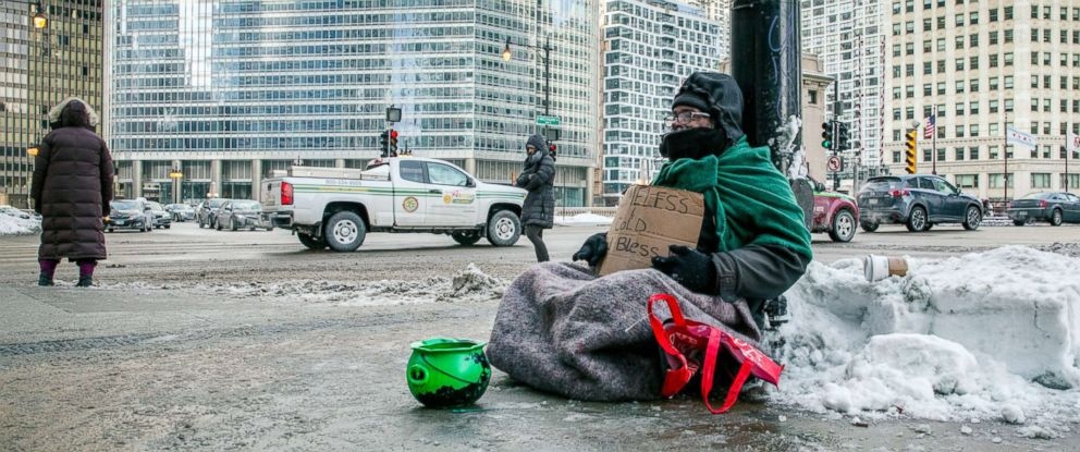 PHOTO: A homeless man panhandles on Upper Wacker Drive in Chicago, Jan. 29, 2019.